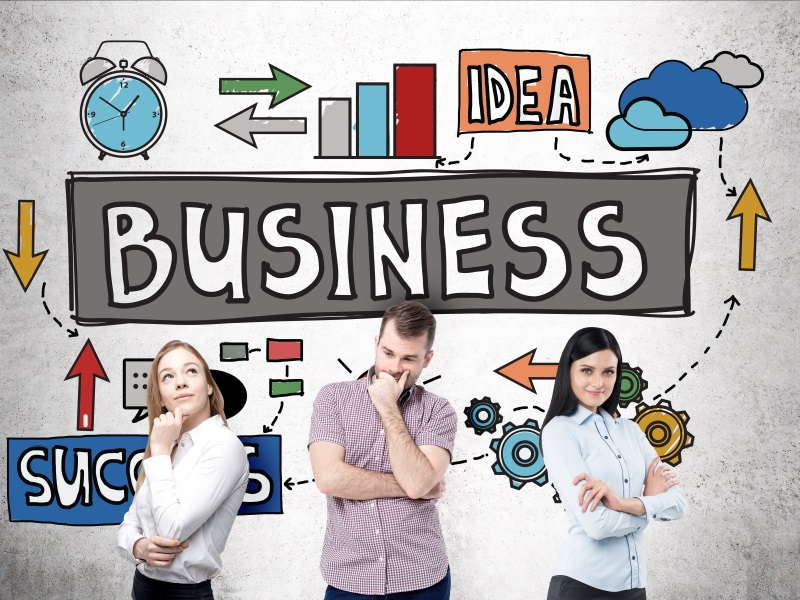 Business idea, success and teamwork concept with thoughtful businesspeople standing against concrete wall with colorful sketch